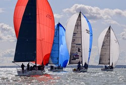 J/111s sailing under spinnaker at Worlds in Cowes, England