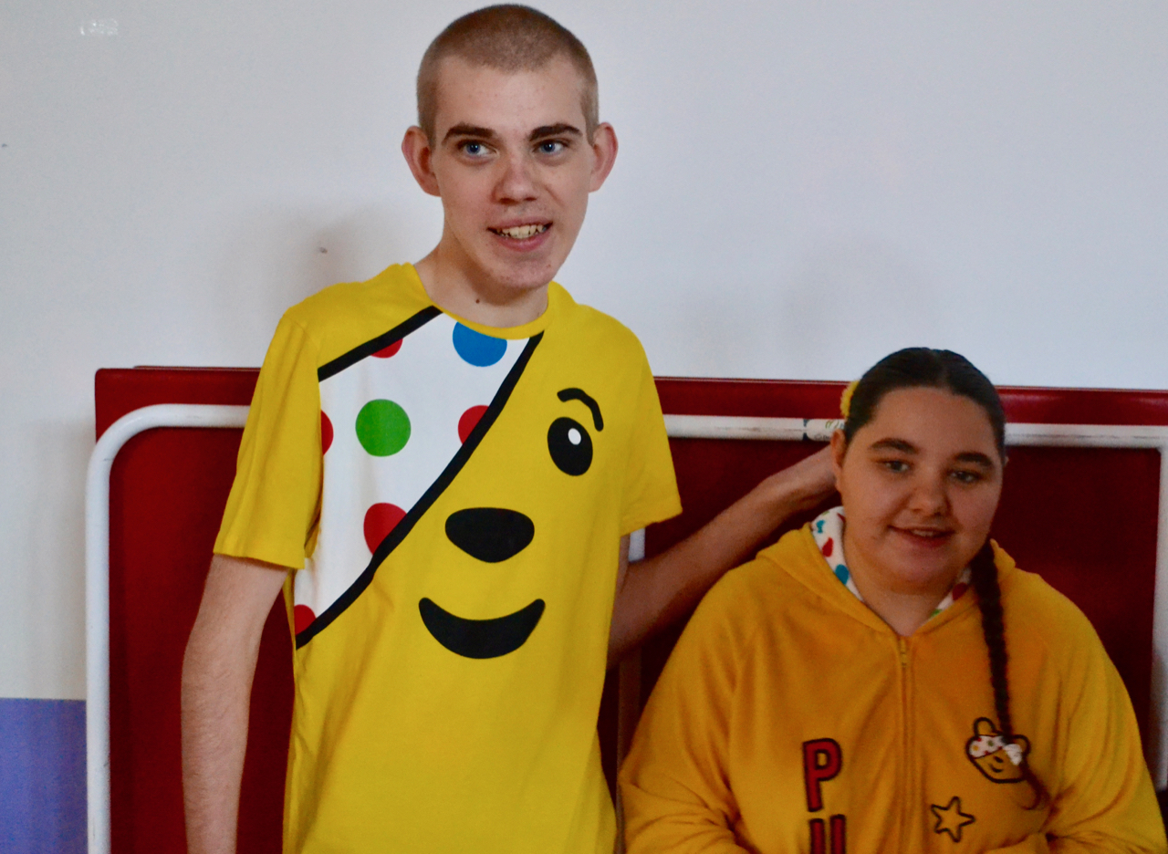 Boy and girl in Pudsey outfits