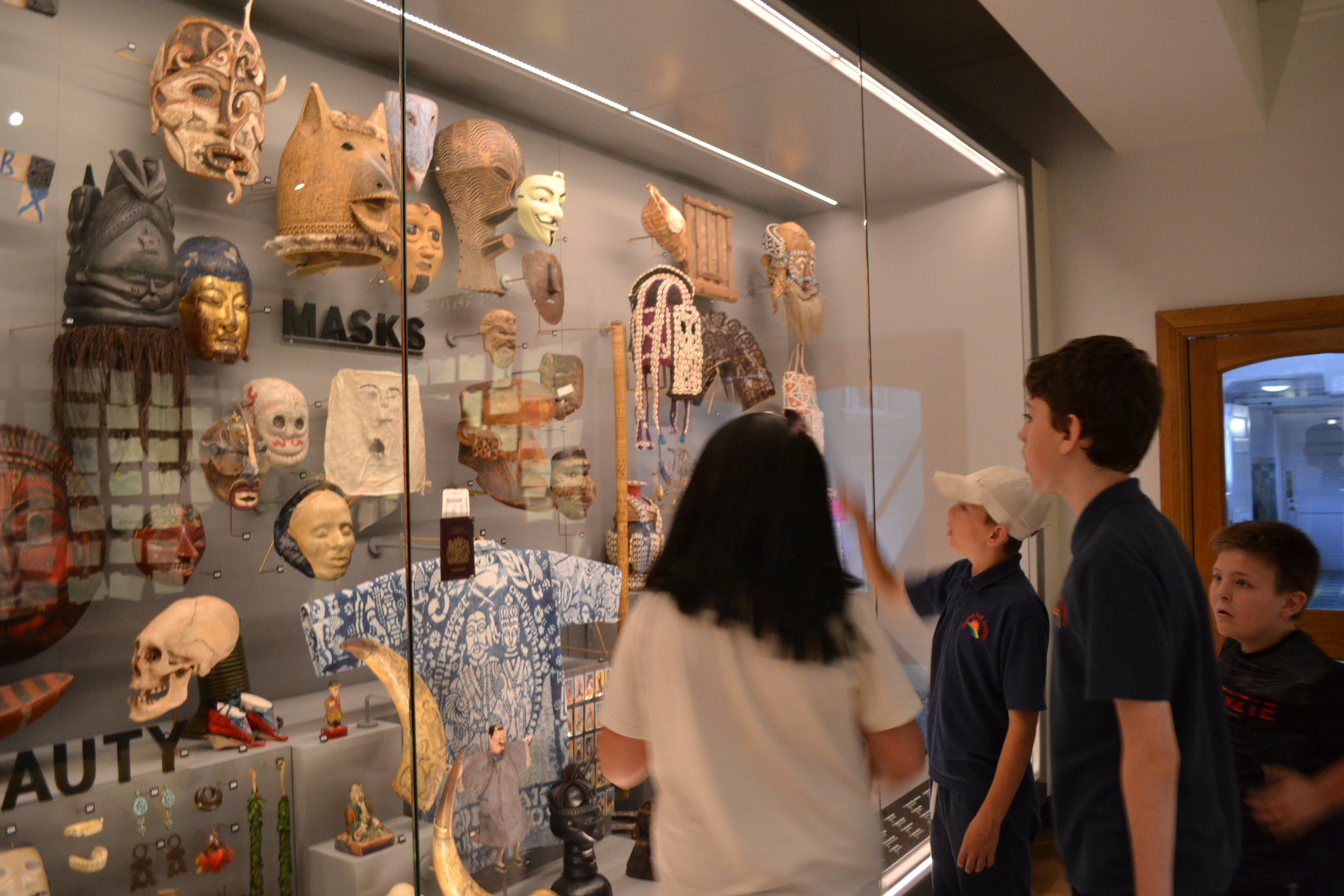 Young people looking at artefacts