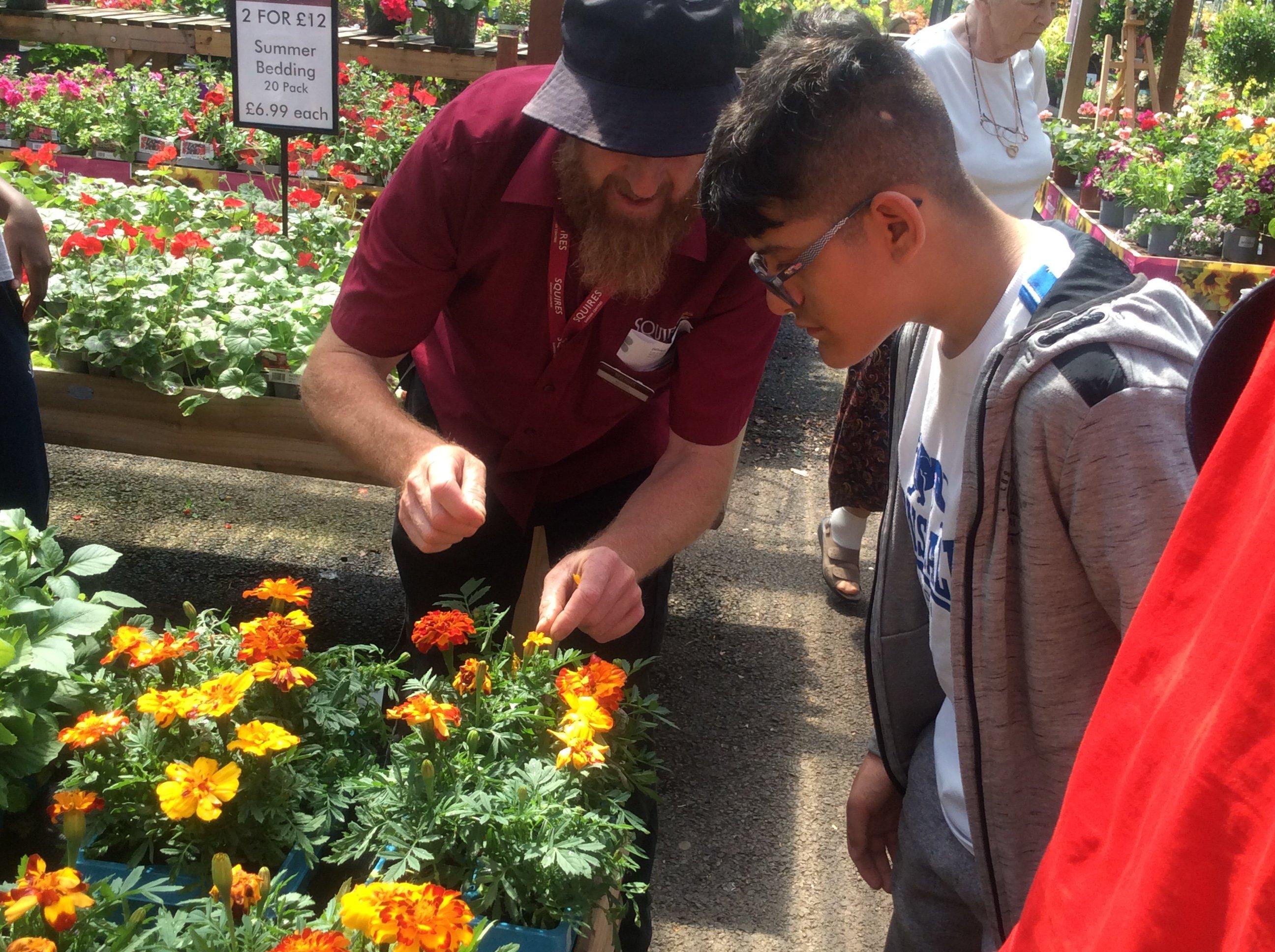 Young person at garden centre