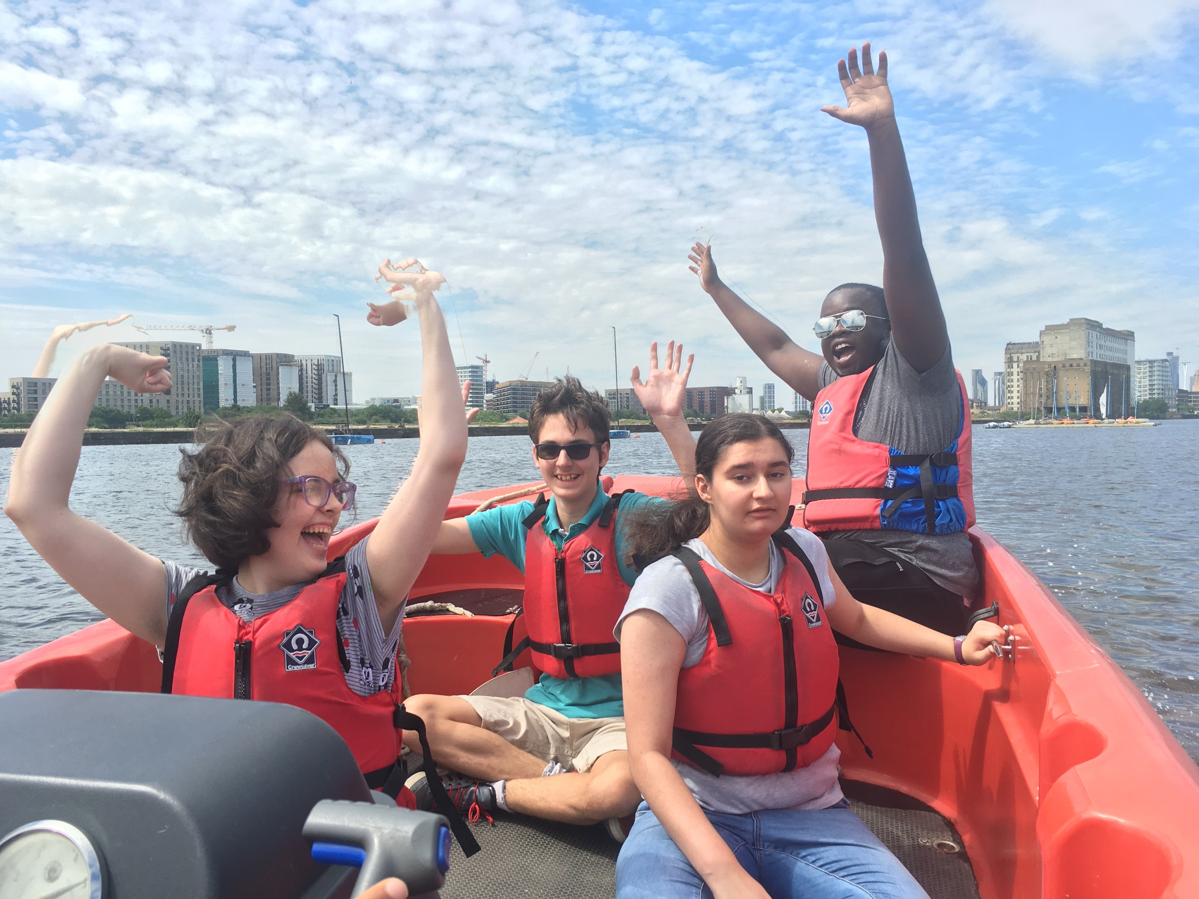 Young adults in a speedboat