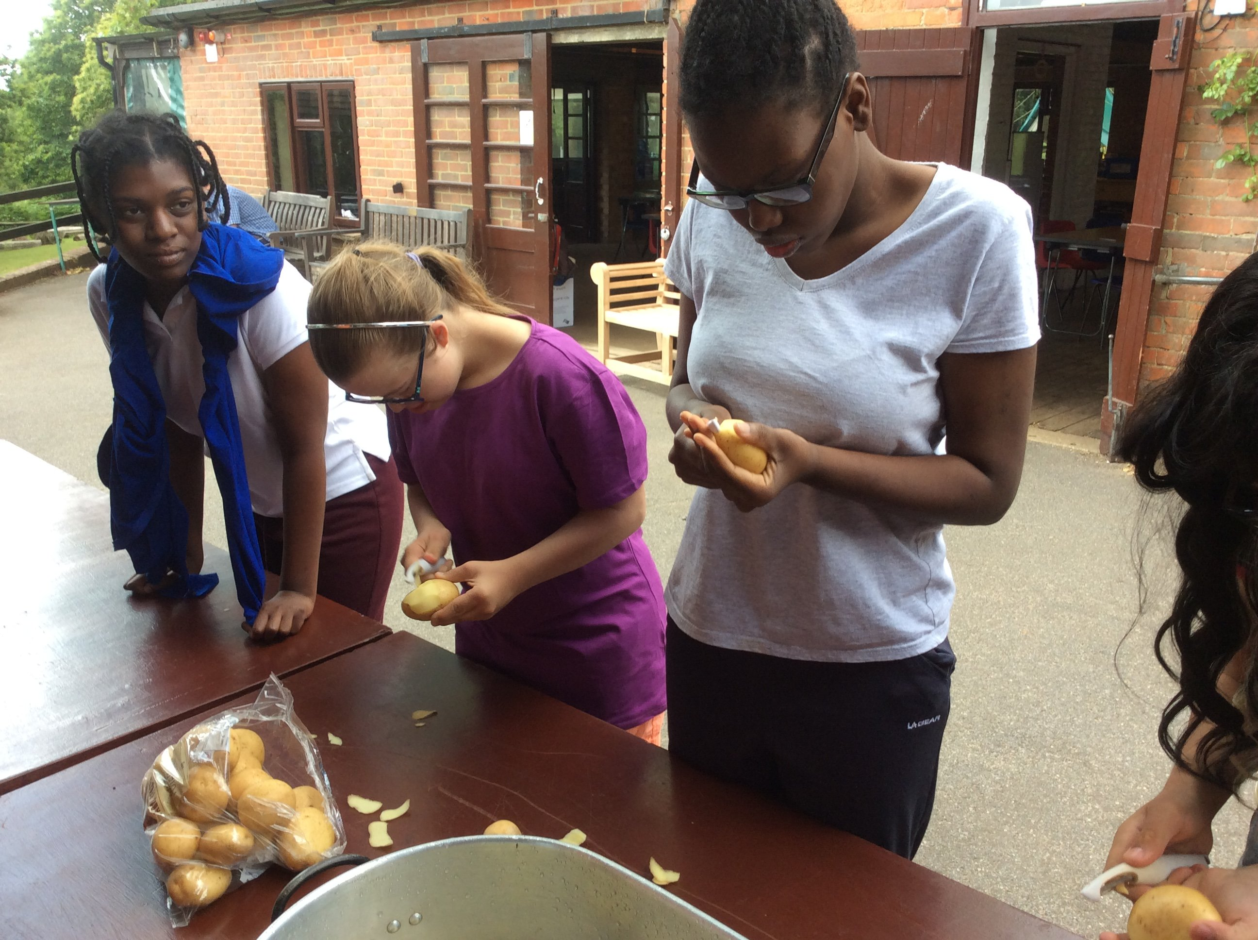 Students cooking outside at residential