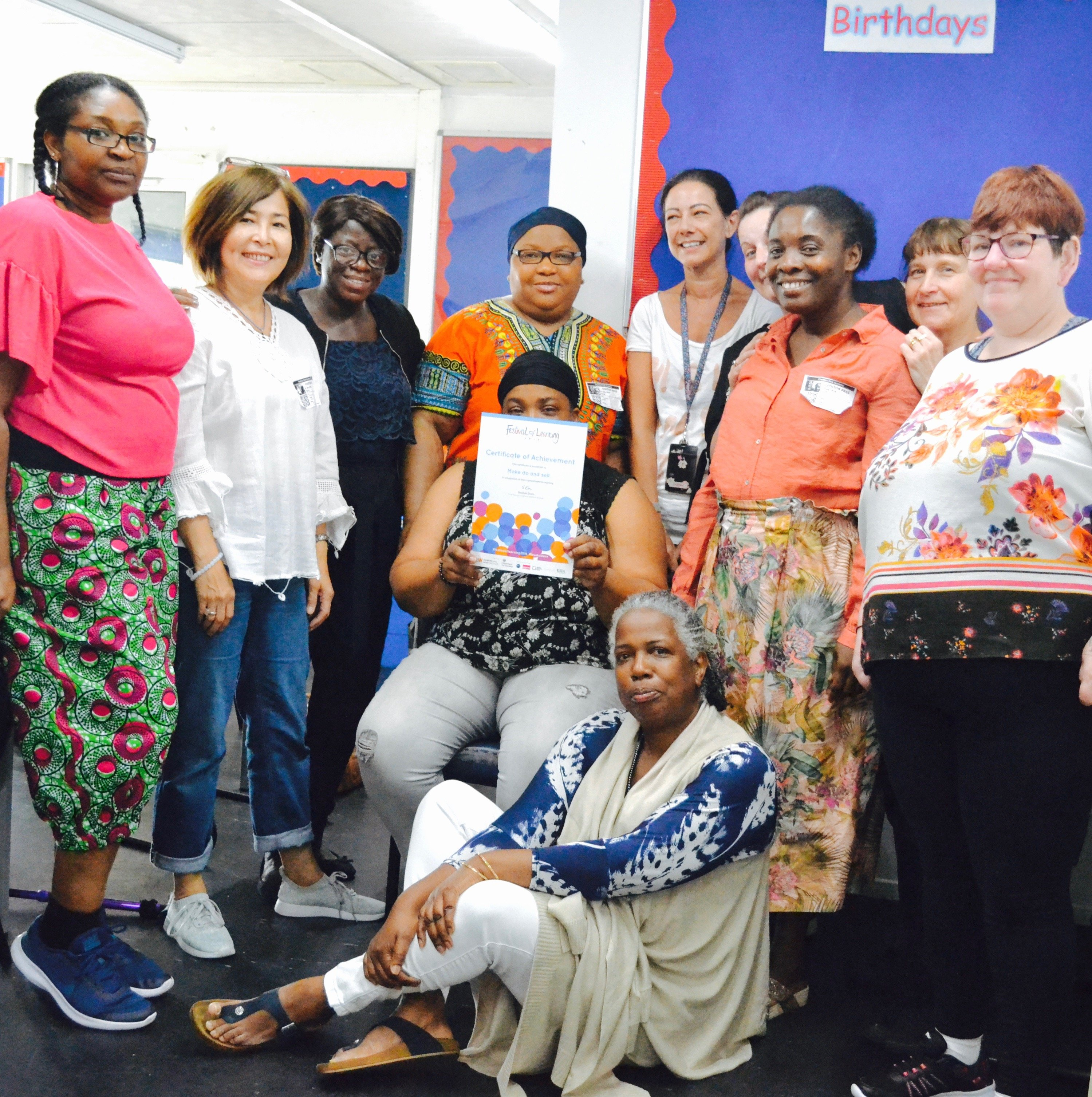 A group of parents/carers with a certificate