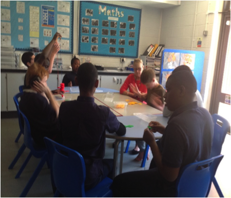 Students around a classroom table
