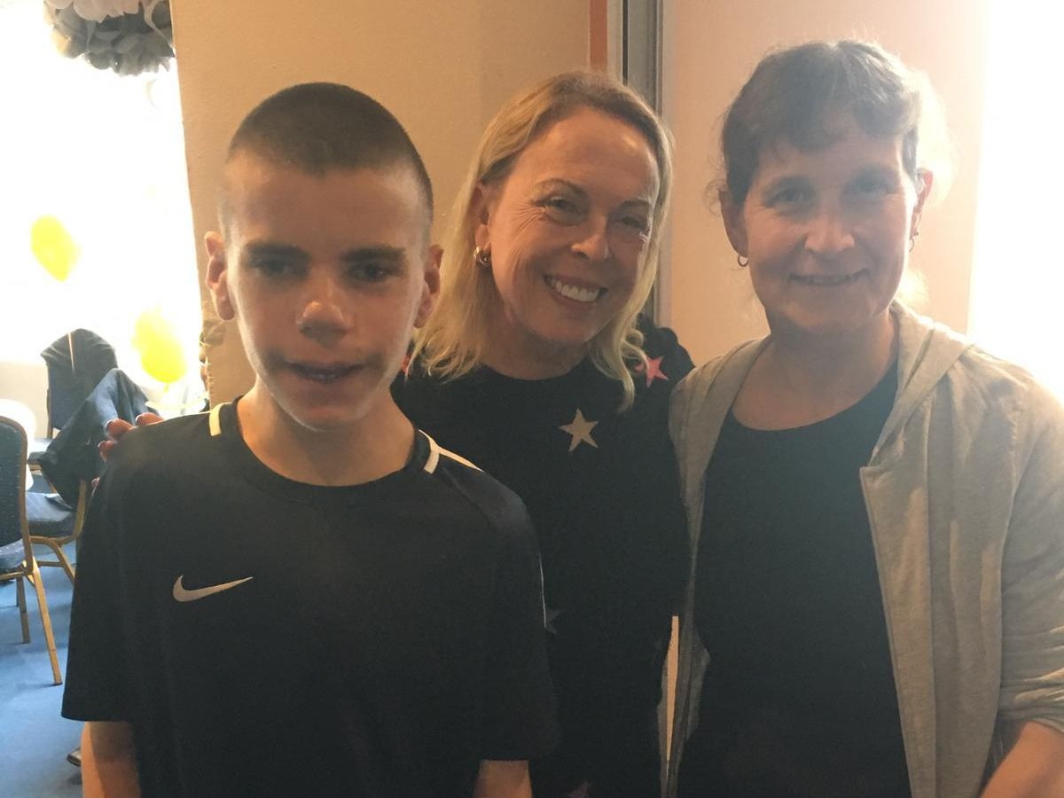 Mother and son with Jane Torvil