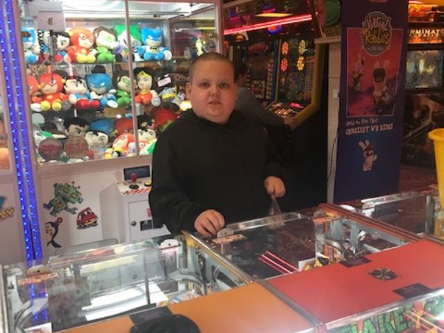 Child in a Hastings arcade
