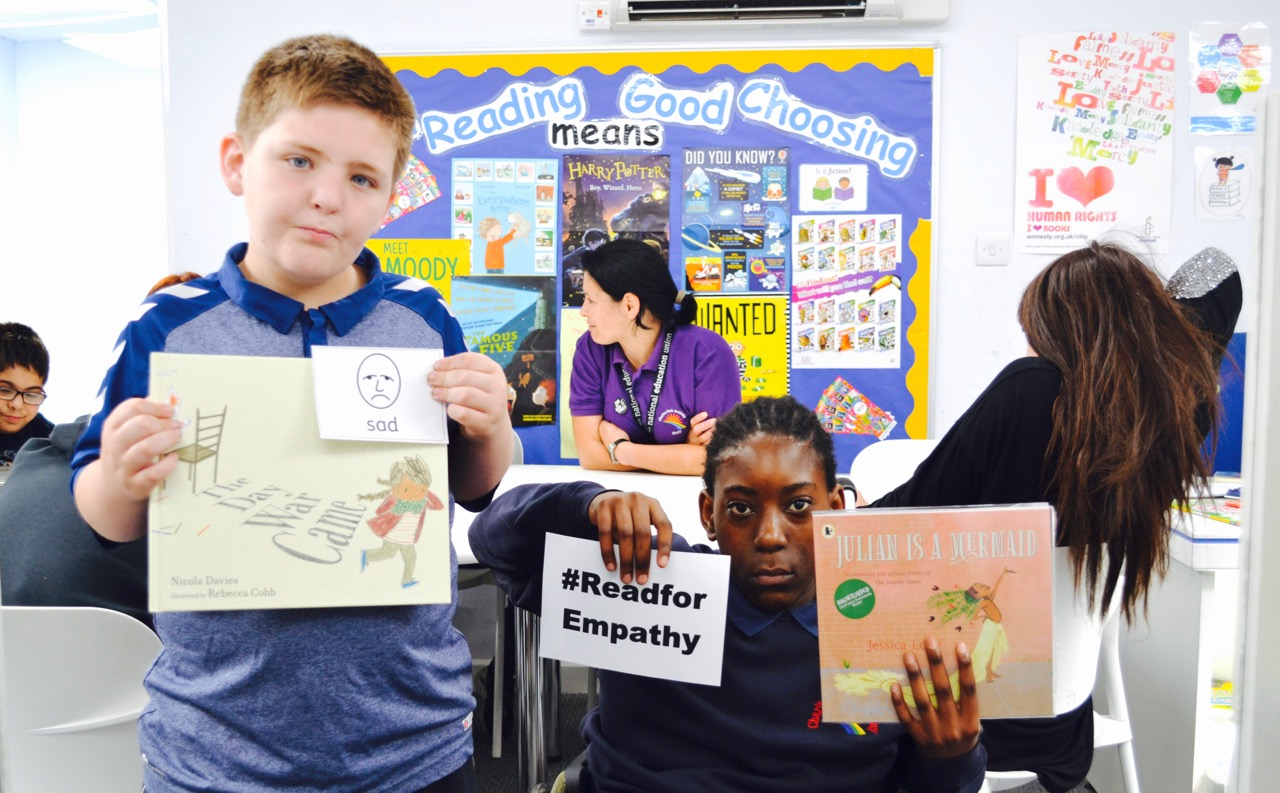 Two students holding up books related to Empathy books