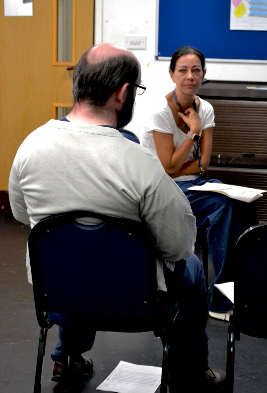 Back of man talking to counsellor