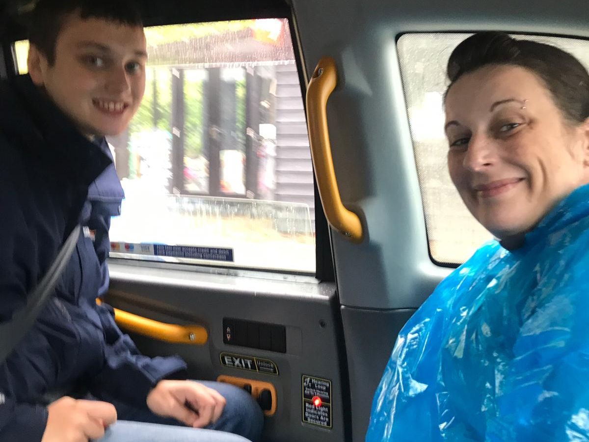 Mum and son in a Black Albany Charity taxi