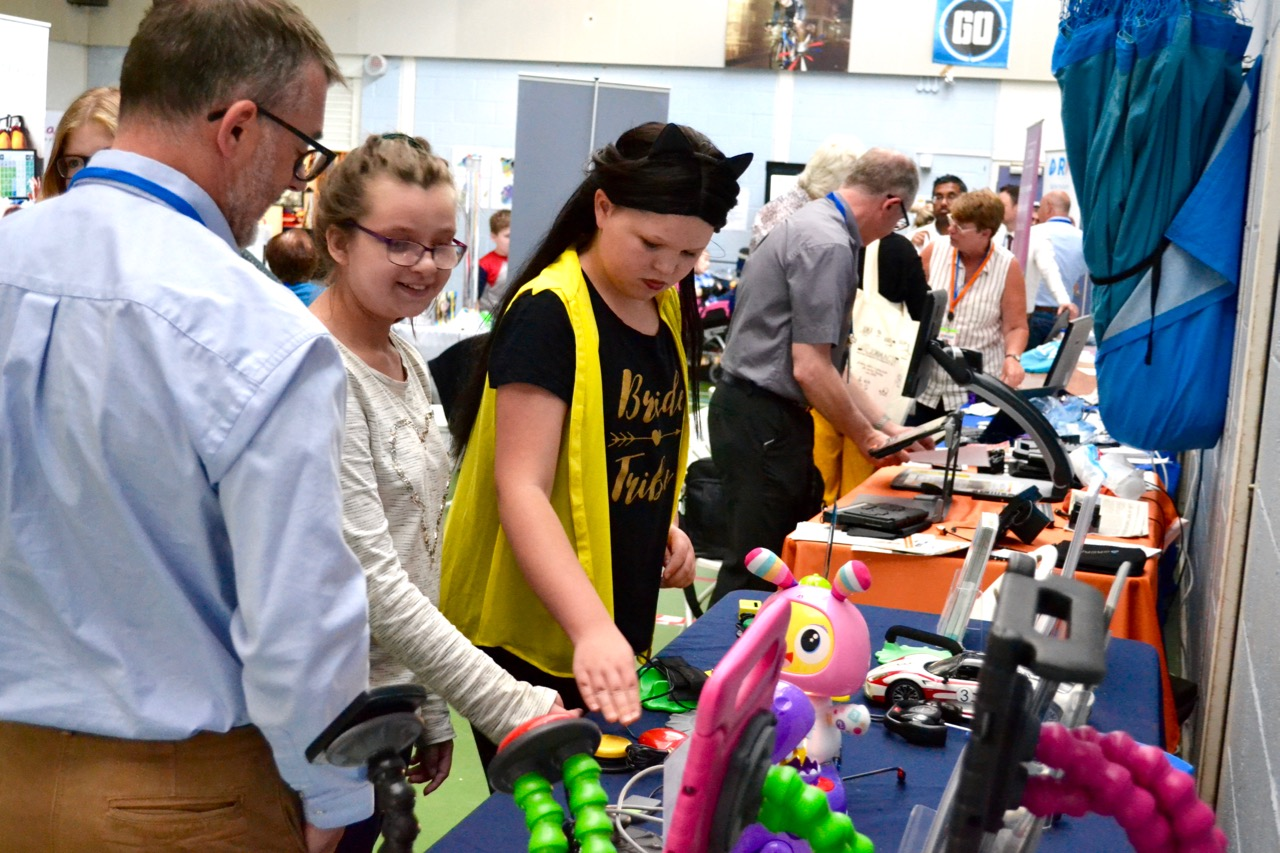 Children looking at technology items at exhibition