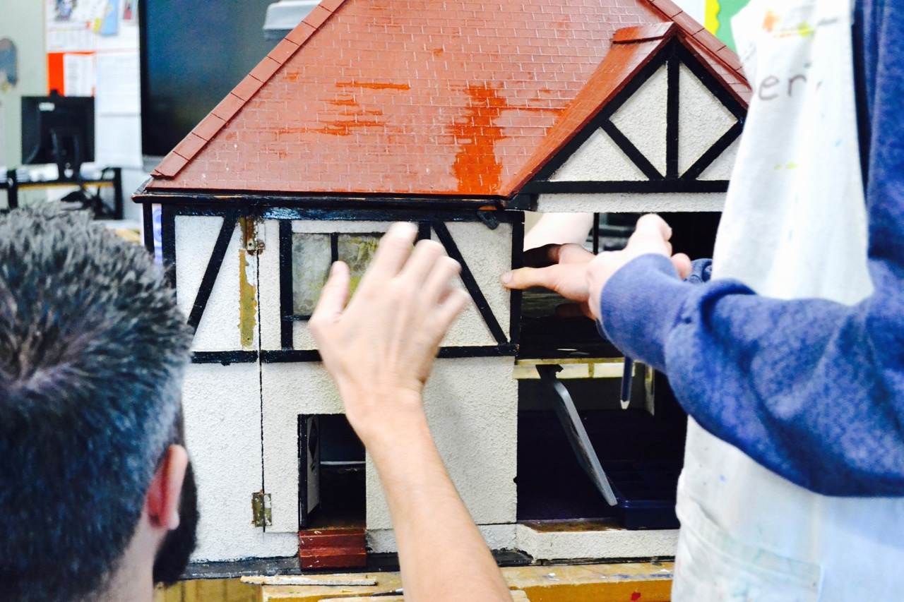 Students building doll's house in DT