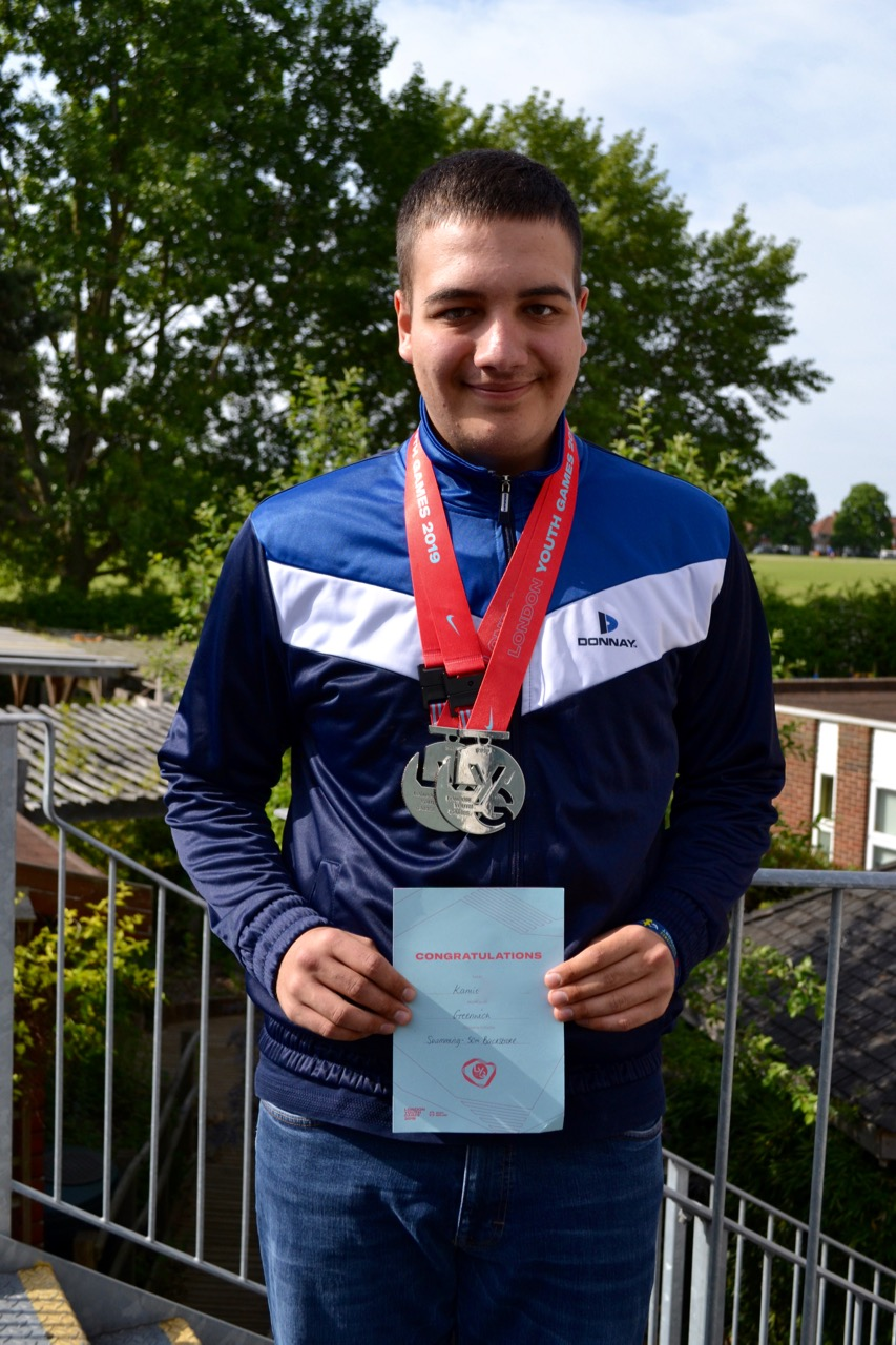 Student with swimming medals
