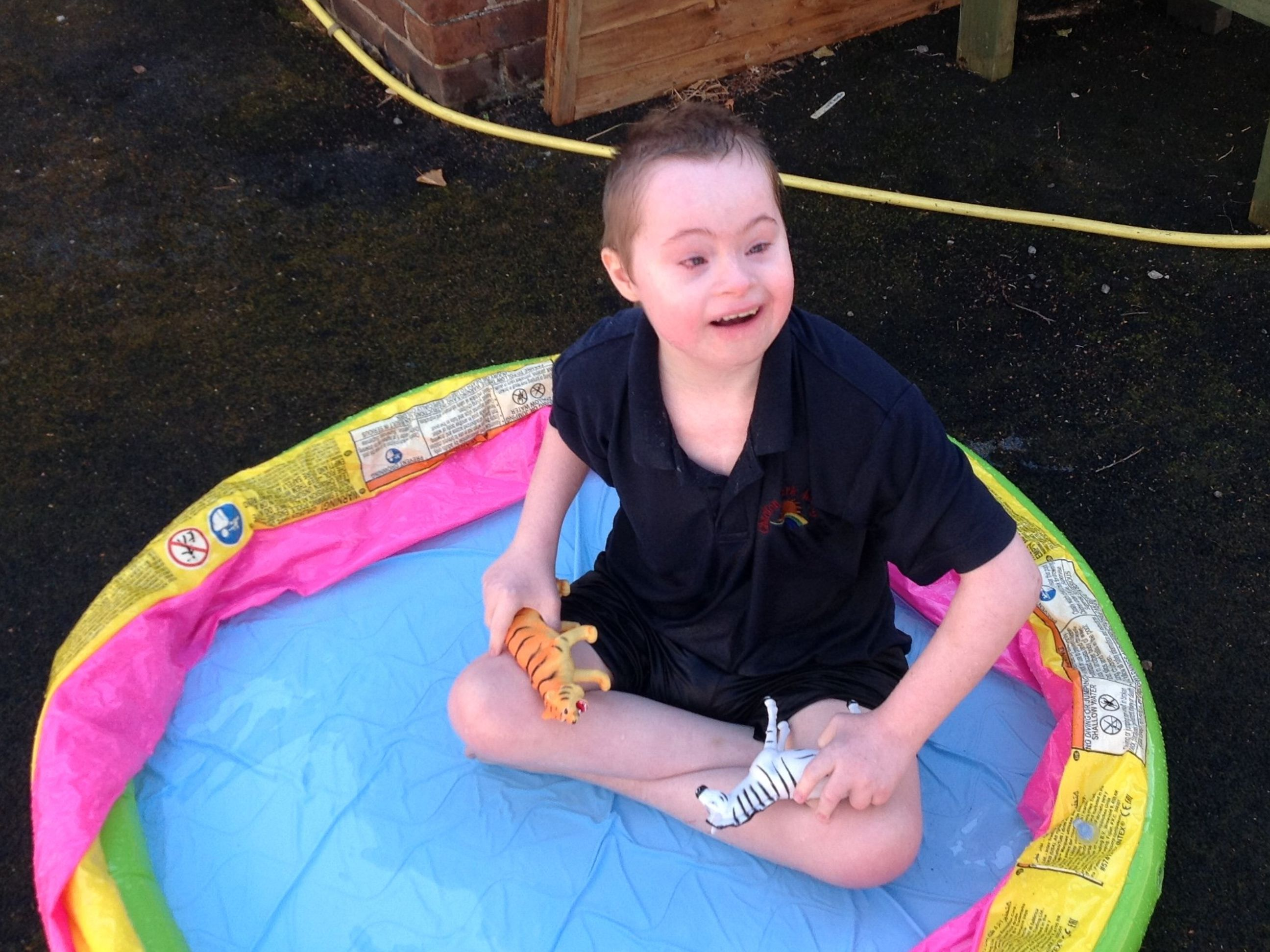 Young person with SEN in a paddling pool