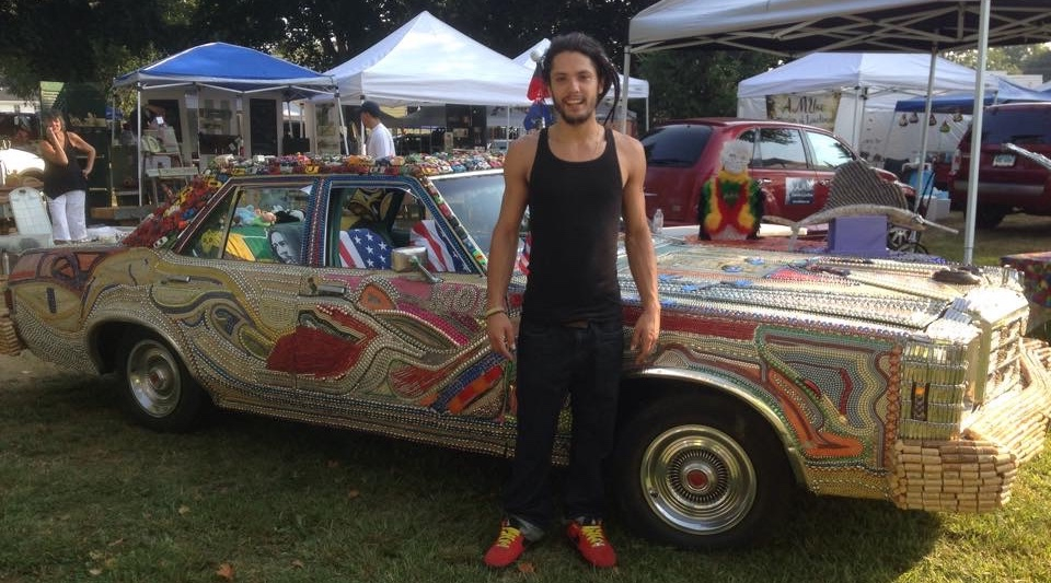 "Tony Mack and his art car ""Hustle Hard"""
