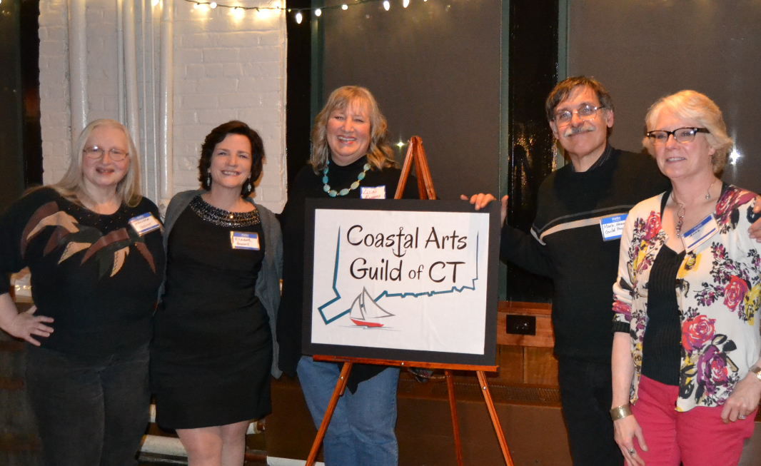 Lisa Romano and the board of the Coastal Arts Guild at the holiday party