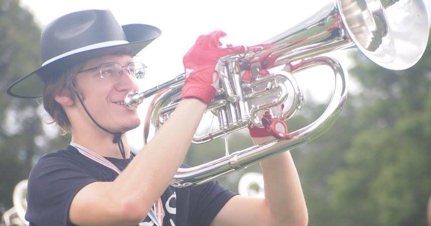 Micheal Pulkka playing large brass instrument