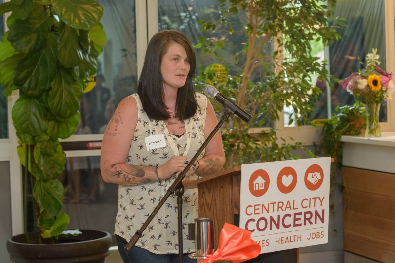 Julie Smith spoke about CCC's recovery and housing services crucial to helping her find stability. She was the event's honorary ribbon cutter.