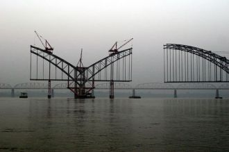 Bridge over the Irrawaddy. Hanging over the China-Myanmar relationship, and dominating every press conference, is the question of the Myitsone dam. Photo: Sean Ryan (flickr.com/aphid)