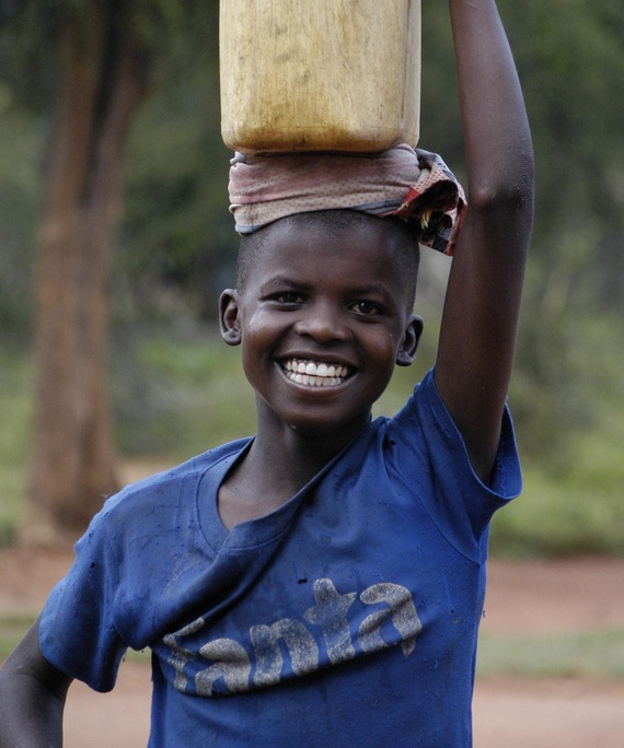 A young boy from Pokot carries water.