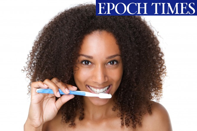 Smiling with toothbrush
