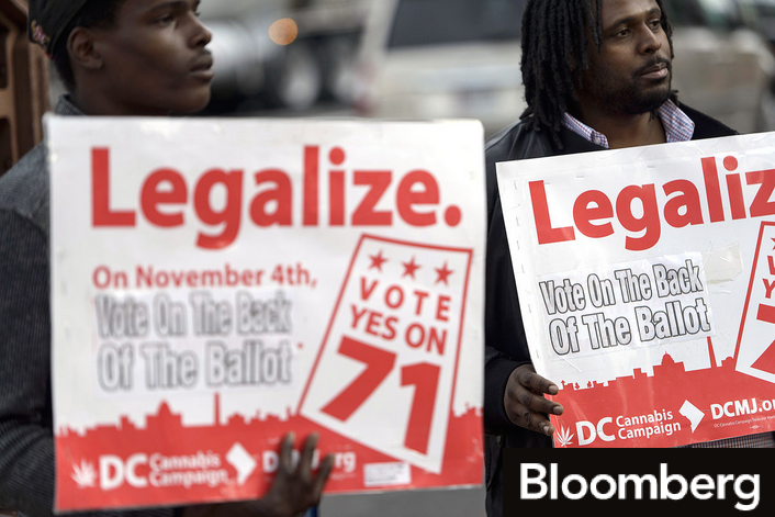 "holding ""Legalize."" posters"