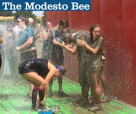 muddy people bathing