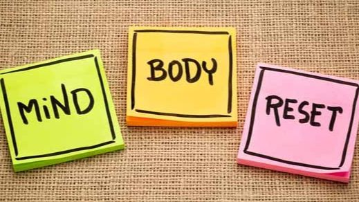 """Sign that reads """"Mind, body, reset"""""""