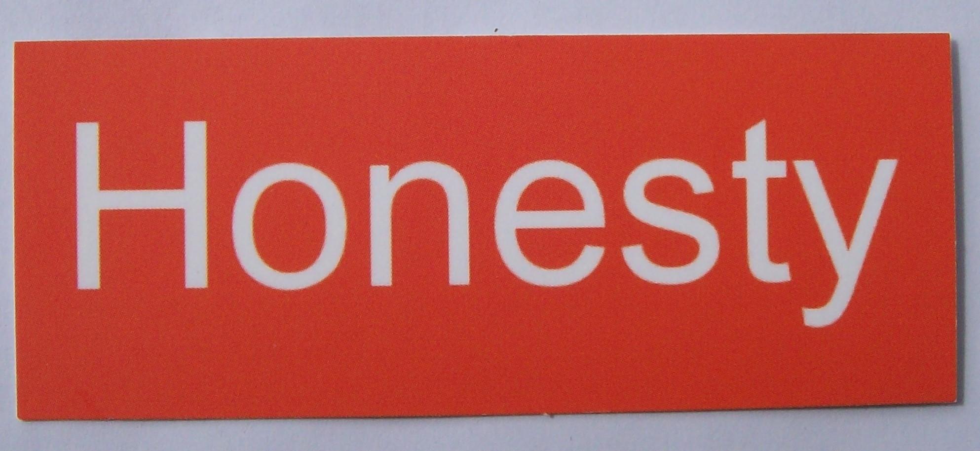 Photo of 'Honesty' card, white text on orange background
