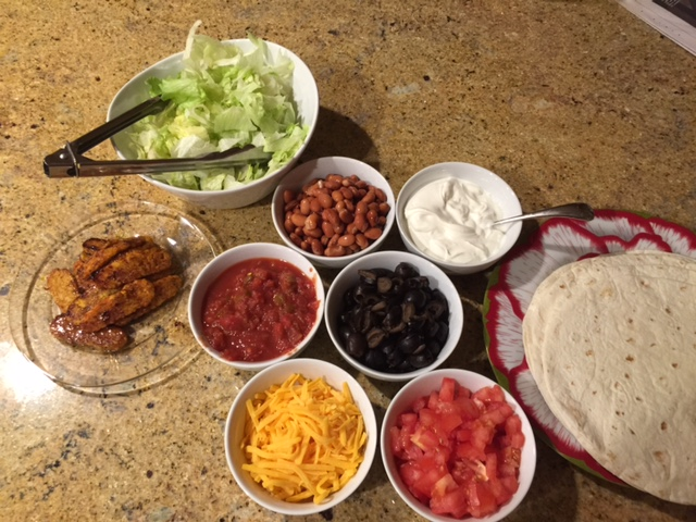 an assortment of dishes for make your own taco night