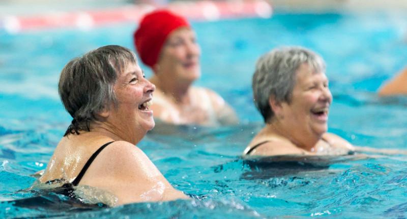 Women having fun during an aquacise session.