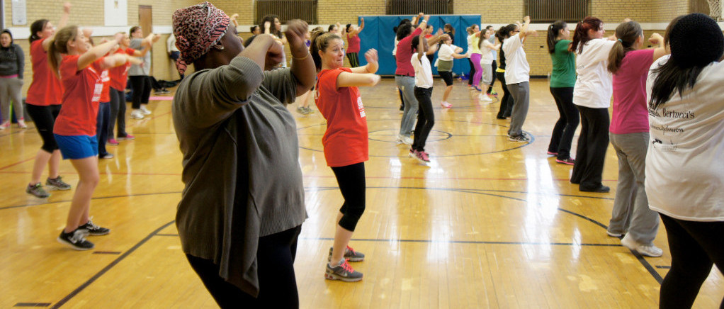 Women of all ages doing a group exercise class.