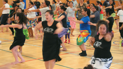 Women enjoying a Pacific-influenced exercise class.