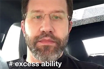 The face of Scott Hanselman with glasses and the text # excess ability