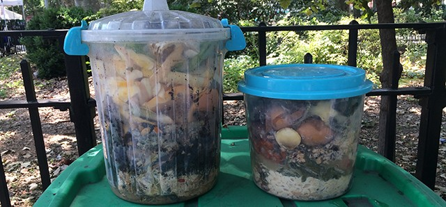 Large, lidded containers filled with food scraps