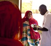 Photo showing health worker and client