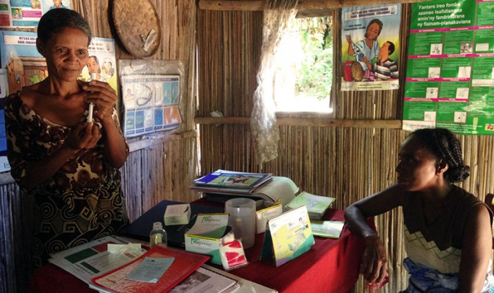 [A community health volunteer in Madagascar demonstrates how to provide Depo-Provera.] {Photo: Colin Gilmartin/MSH}