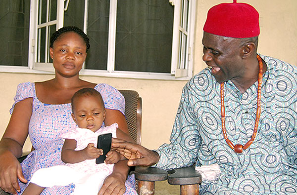 Nigeria: Chief Ntuen, his wife, and baby Rosemary. [Photo: MSH staff]