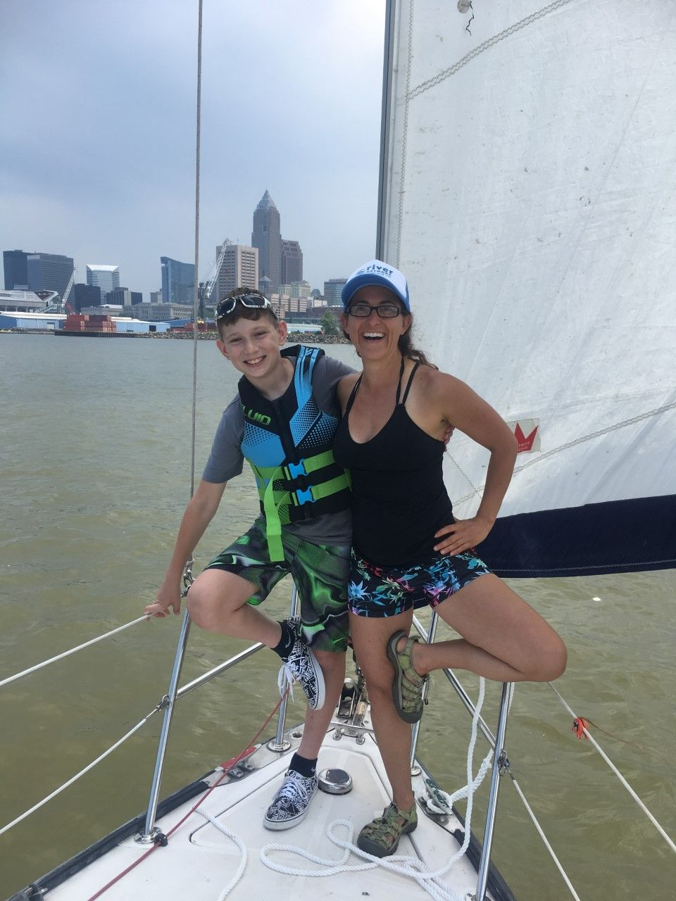 Lisa and nephew finding tree pose while sailing in Lake Erie, July 2019