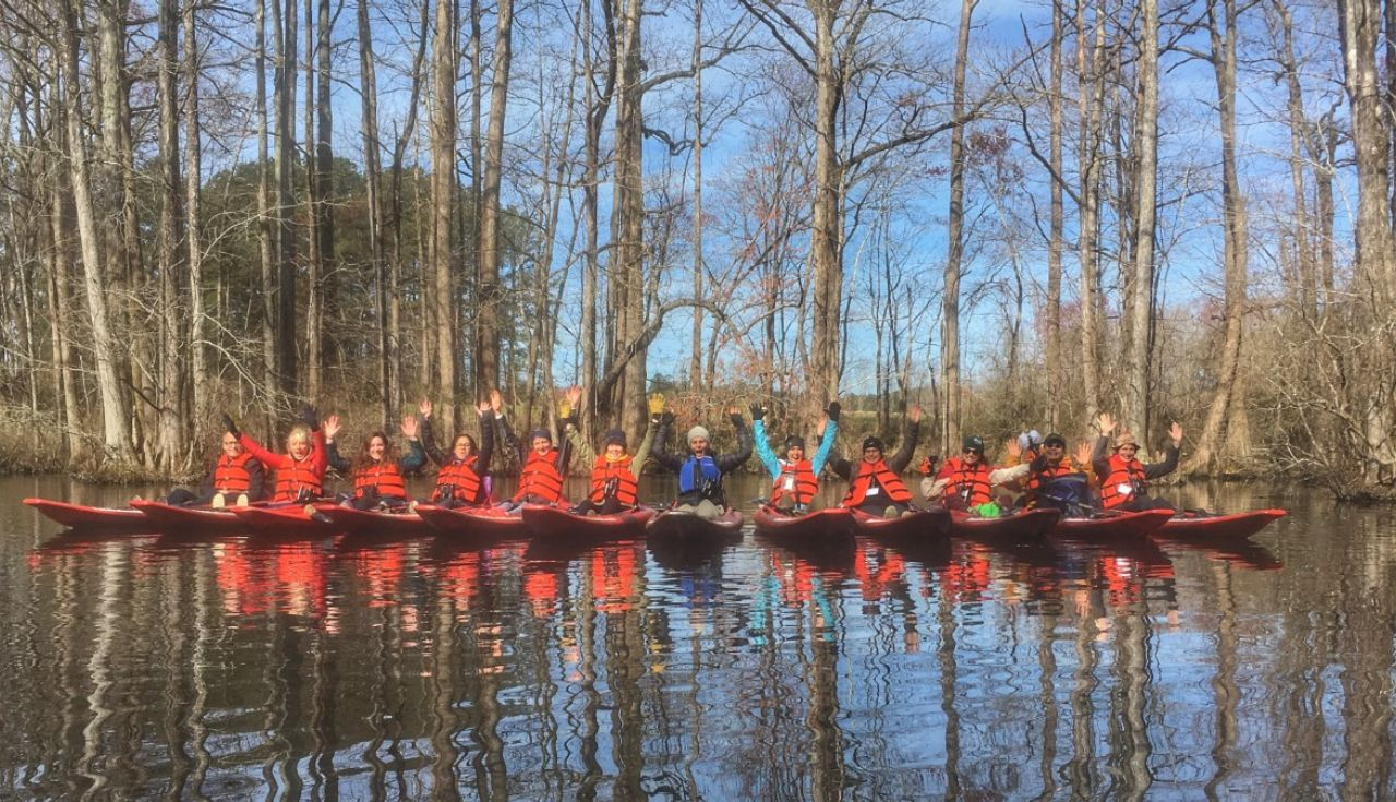Group kayaking in a North Carolina swamp
