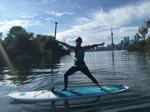 Lisa in warrior 2 pose on the waters of Toronto Island@ Toronto, Canada  Aug2019