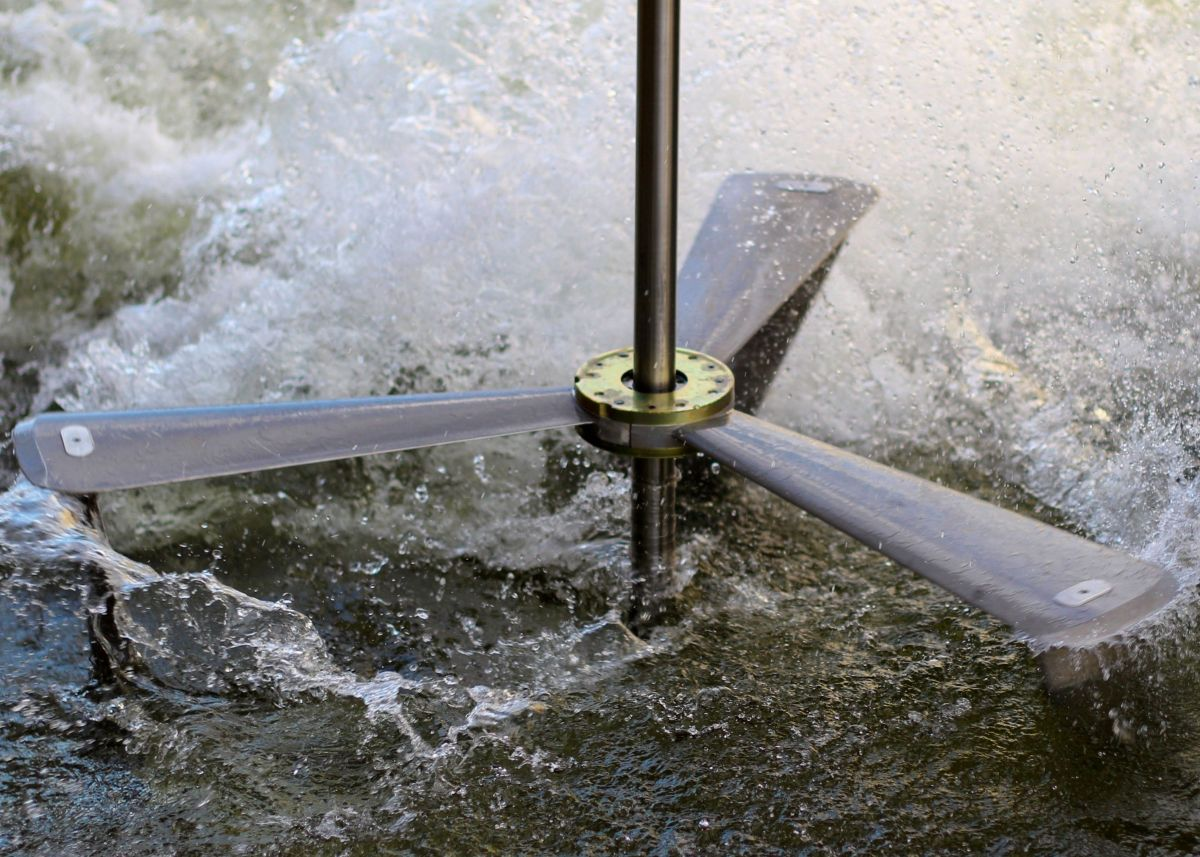 Close up of the spokes of an Emrgy turbine operating in the water