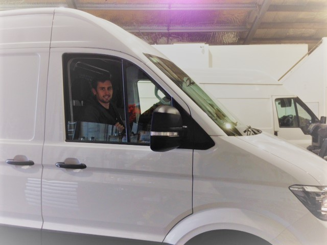 Aiden in the new van
