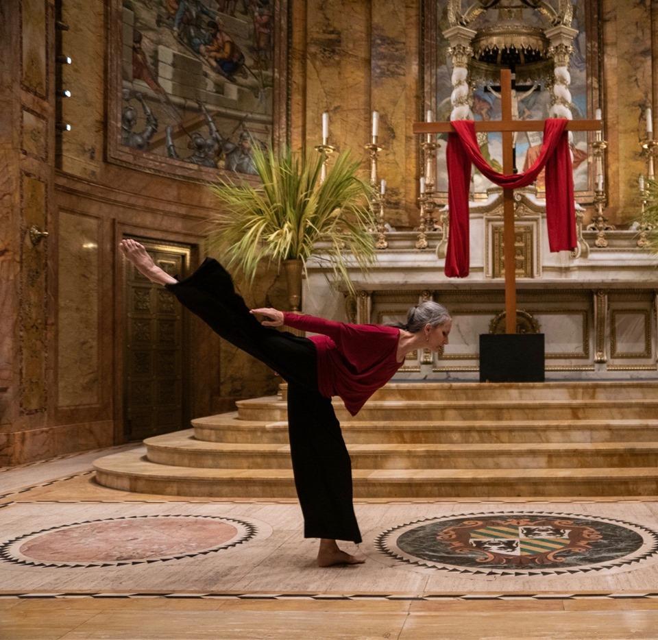 Omega dancer in arabesque during performance