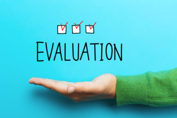 """The word """"evaluation"""" in the palm of a hand"""