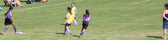 Rachel & Lori playing soccer