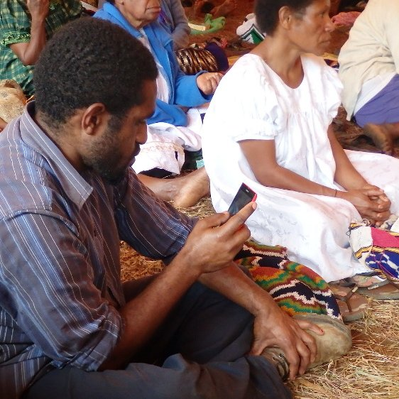 Smart phone in PNG, photo by Brian Chapaitis