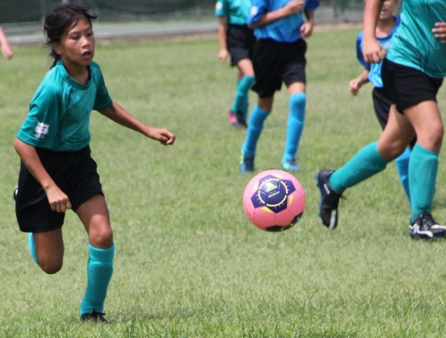 Rachel playing soccer
