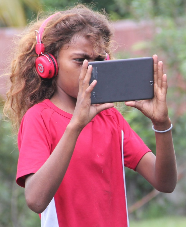 Girl with Android tablet in Vanuatu