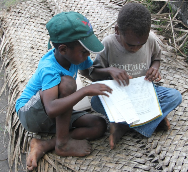 Boys with New Testament in their own language