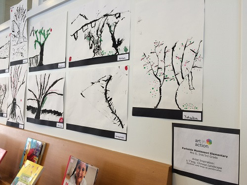 Close up of Student tree drawings (black and white) on display at public library.